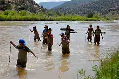 The students familiarized themselves with walking in the river in waders, Sept. 6, 2017.