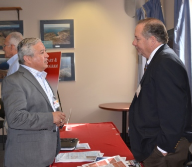 Kris Schafer, chief of the District's Planning Branch, speaks with a small business representative Feb. 26, 2015.
