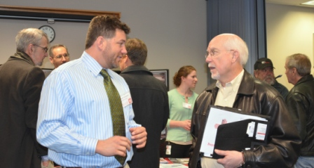 A District contract representative speaks with a small business representative during the open house.