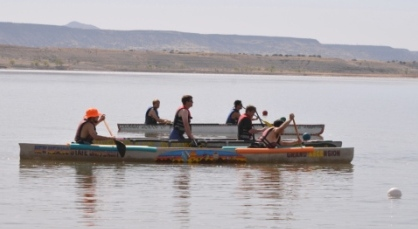 Teams get their canoes lined up to start the race on Cochiti Lake