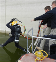JOHN MARTIN DAM, Colo., - A diver from the Army's 511th EN Dive DET of Fort Eustis, Va., enters the reservoir.