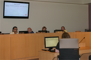 Sandoval County Planning and Zoning Commission members listen as District Dam Safety Manager Suzi Hess-Brittelle discusses risks related to flooding.
