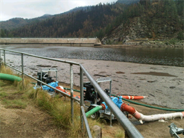 Pumps pull water to help lower Bonito Lake.
