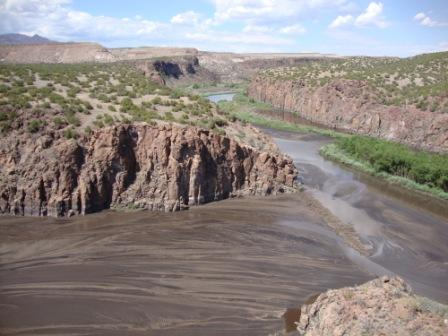 Ash and debris flow downstream during flooding