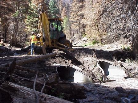 Clean up in Santa Clara Canyon after flooding
